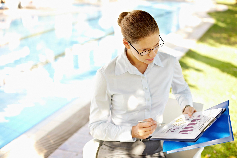 Pool inspector reviewing regulations